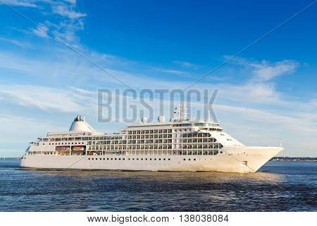 White cruise ship passes barrage gates Gulf of Finland in St. Petersburg
