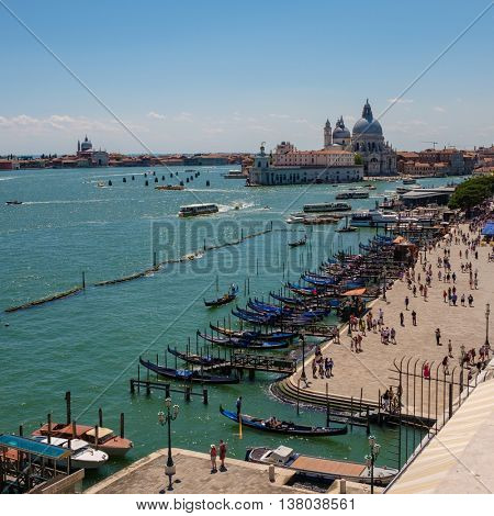 Beautiful view on the cityscape of Venice with gondola park on Grand Canal with Santa Maria della Salute church.