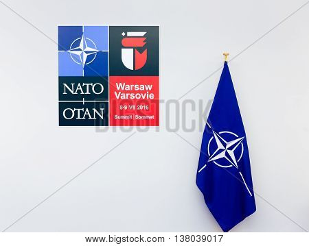Emblem And The Flag Of Nato Sammit In Poland