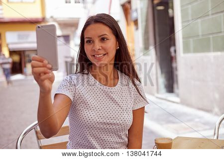 Joyously Smiling Young Girl Taking Pictures