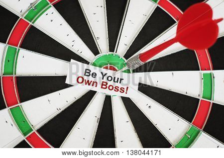 Be Your Own Boss. Sticker with text and a dart in a center of target