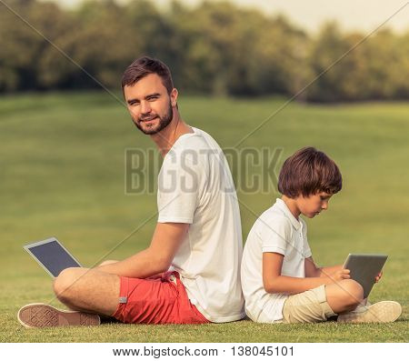 Dad And Son With Gadget