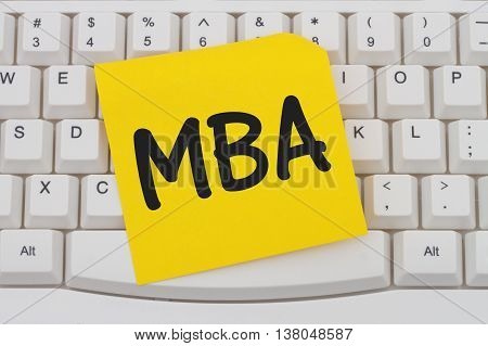 Getting your MBA online A close-up of a keyboard with yellow sticky note with text MBA