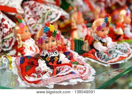KRAKOW POLAND - JULY 5 2016: Vendor sells Polish traditional handicraft souvenirs in Sukiennice (Cloth Hall).
