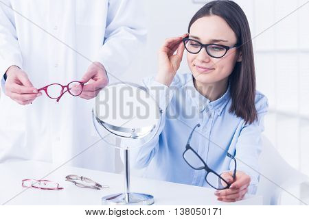 Woman With Vision Defect And Optician's Consultation