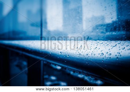 raindrops on window,blue toned image