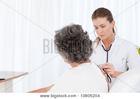 Nurse taking care of her patient