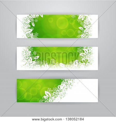 Vector summer banners. Set of three horizontal banners with green blurred background and white floral frame.
