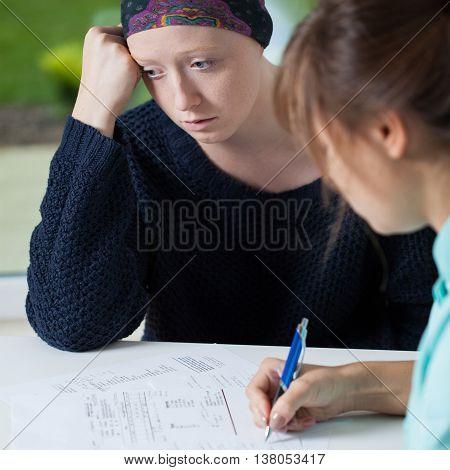 Cancer Specialist Writing Prescription
