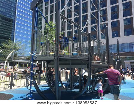 TYSONS CORNER, VIRGINIA - July 3, 2016. An outdoor playground for families on the 3rd floor of Tysons shopping center next to a popular fast food burger place called Shake Shack.