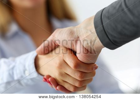 Two businesswoman shake hands as hello in office closeup. Friend welcome introduction greet or thanks gesture product advertisement partnership approval arm strike a bargain on deal concept