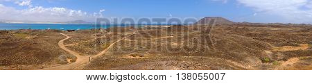 A landscape with mountains ways a beach and a lagoon on the Canary island Lobos in Spain.