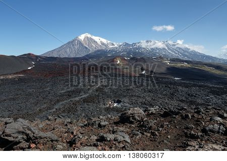 Volcanic landscape of Kamchatka Peninsula: beautiful view of Tolbachik Volcanic Massif - cone of dormant Ostry Tolbachik Volcano and cone of active Plosky Tolbachik Volcano on a clear sunny weather. Eurasia Russian Far East Kamchatsky Region Klyuchevskaya