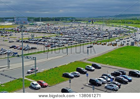 ST PETERSBURG RUSSIA - MAY 11 2016. Birds eye view of airport auto crowded parking lot in Pulkovo International airport in St Petersburg Russia