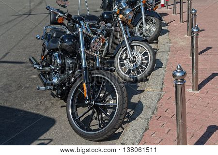 Classic motorcycles parked on a city street. Transport