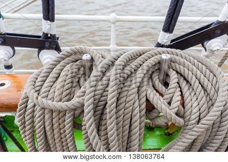 Thick ship vessel rigging rope in various shapes and colors on a boat