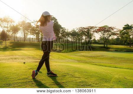 Asian woman golfer playing golf at golf course in the summer.