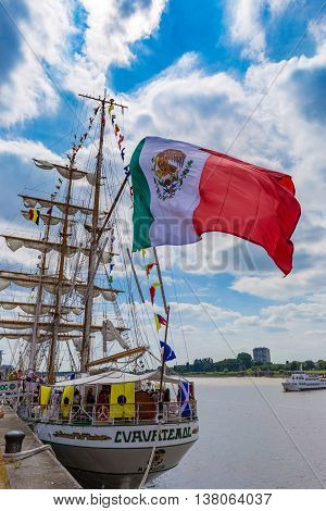 Sailing ship Cuauhtémoc seen wth huge waving Mexican flag in Antwerp during the Tall Ships Races 2016 event