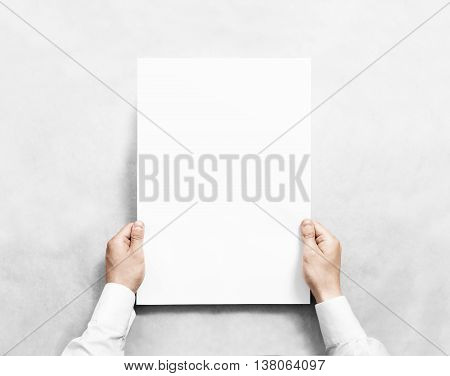 Hand holding white blank poster mockup, isolated. Arm in shirt hold clear broadsheet template mock up. Affiche bill surface design. Broadside pure print display show. Sticking a3 poster on the wall.