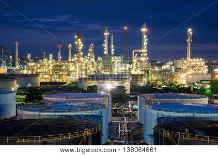 Oil refinery or petroleum refinery and storage tanks in night.