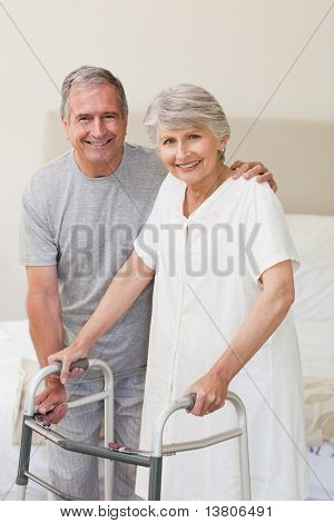 Man helping his wife to walk