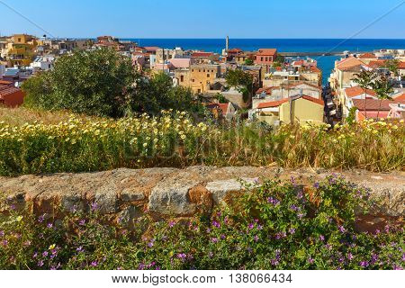 The medieval city with lighthouse in old harbour, aerial view from Schiavo Bastion in the sunny morning, Crete, Greece
