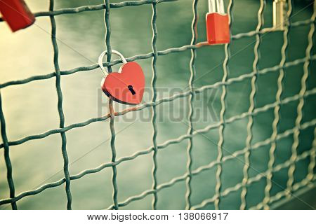 Love padlocks on the railing of a bridge, Berlin, Germany.