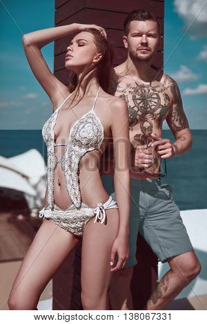 Fashion Beautiful Couple Getting A Suntan
