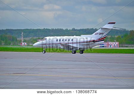 SAINT PETERSBURGRUSSIA -MAY 11 2016. CS-DRY NetJets Europe Airlines Hawker Beechcraft Hawker 800XP business jet airplane. Airplane rides on the runway after arrival at Pulkovo Airport