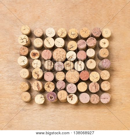 corks in square over a wood surface