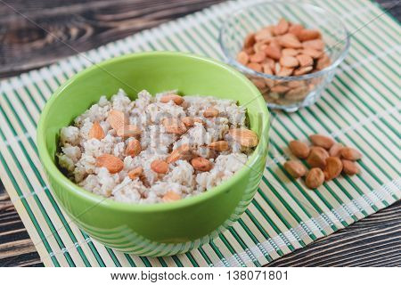 Porridge Oats with Nuts on Wooden Tables. Healthy Food Concept