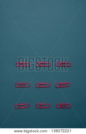 Close-up Of Pink Paperclips On Blue Background