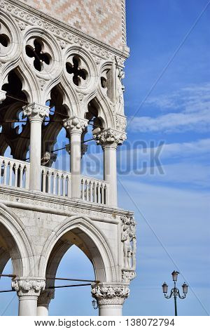 Doge Palace corner with gothic gallery and beautiful sky