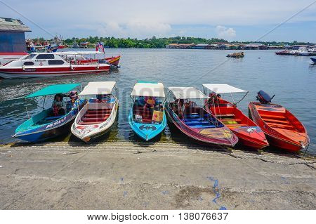 Labuan,Malaysia-July 11,2016:Labuan water taxi waiting for customer in the jetty at Labuan island on 11th July 2016.This is main transport to water village Patau Patau & Muslim Labuan Pearl of Borneo
