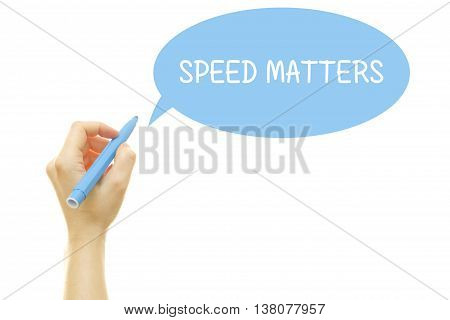 Woman hand writing SPEED MATTERS message isolated on white.