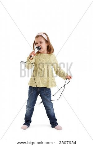 Cute little girl playing with microphone, singing.?