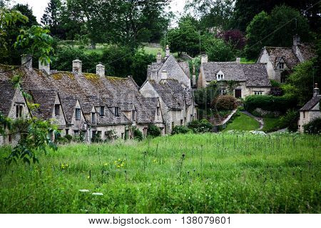 Traditional Cotswold cottages in England, UK. Bibury is a village and civil parish in Gloucestershire, England.
