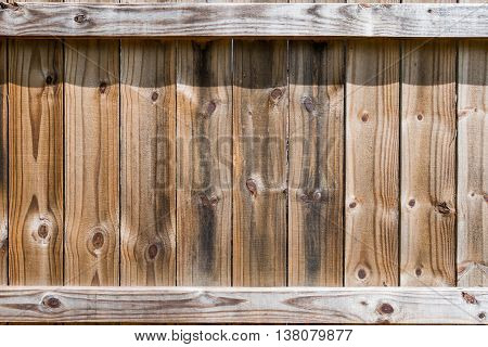 Wooden Fence Section from the backside shows vertical slats with horizontal supports