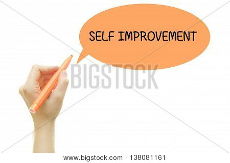 Woman hand writing SELF IMPROVEMENT with a marker isolated on white.