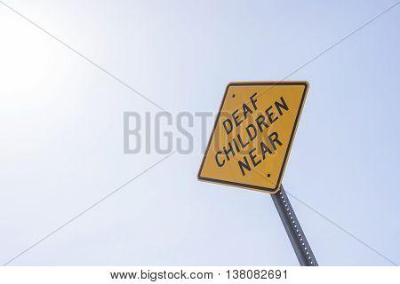 Lone Deaf Children Near Yellow Warning Sign