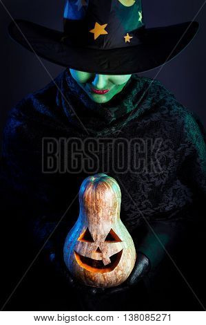 Wicked Witch With Pumpkin