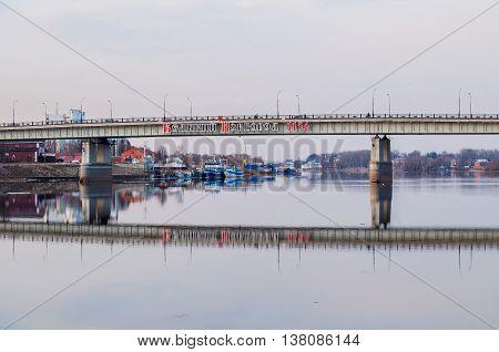 VELIKY NOVGOROD RUSSIA - MARCH 26 2016. Road bridge over Volkhov river in Veliky Novgorod Russia with the inscription Veliky Novgorod 1156 - city landscape in the spring quiet evening
