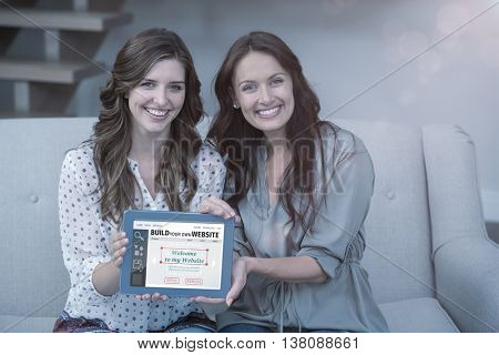 Composite image of build website interface against two beautiful woman holding digital tablet