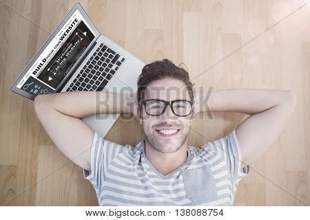 Composite image of build website interface against overhead portrait of a man using laptop