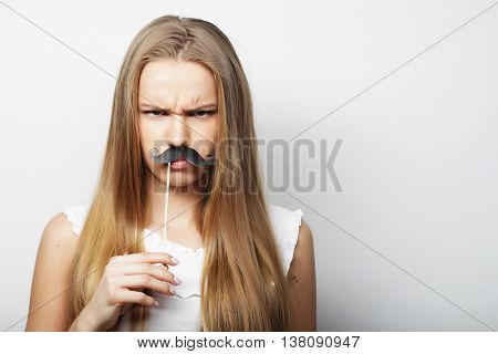 Young woman with  fake mustaches.