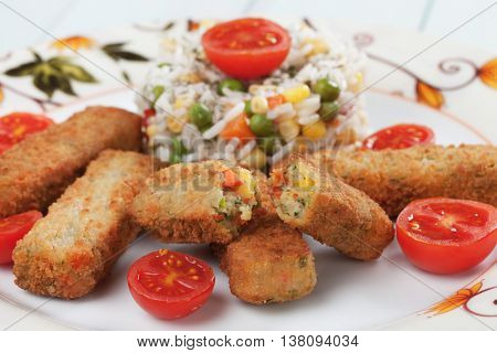 Breaded veggie sticks or croquettes with cooked rice