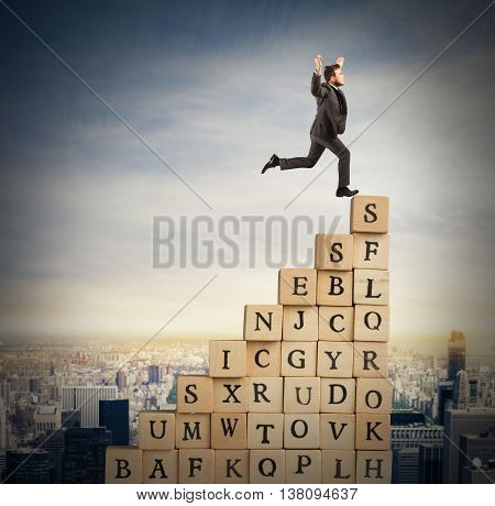 Businessman climb a staircase cubes wooden letters