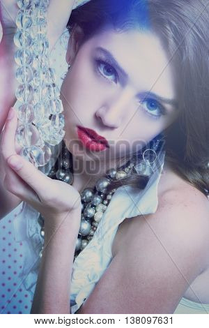 Beautiful fashion woman holding beads