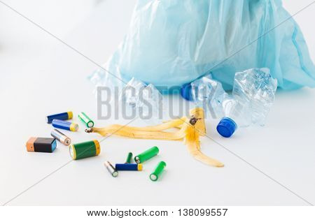 waste recycling, reuse, garbage disposal, environment and ecology concept - close up of rubbish bag with trash or garbage