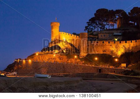 Fortress and fishing boats of Tossa de mar Costa brava Spain